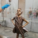 Lewes artist's 'Fearless Girl' sculpture appears in Paris for UN Day of the Girl