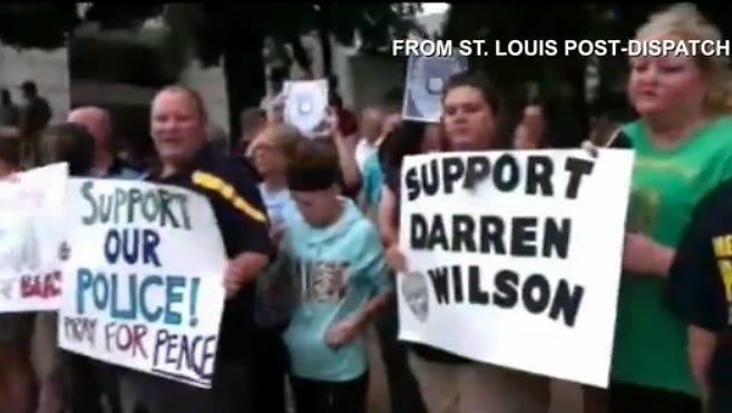 People demonstrate in support of Ferguson, Mo., police officer Darren Wilson in St.Louis.