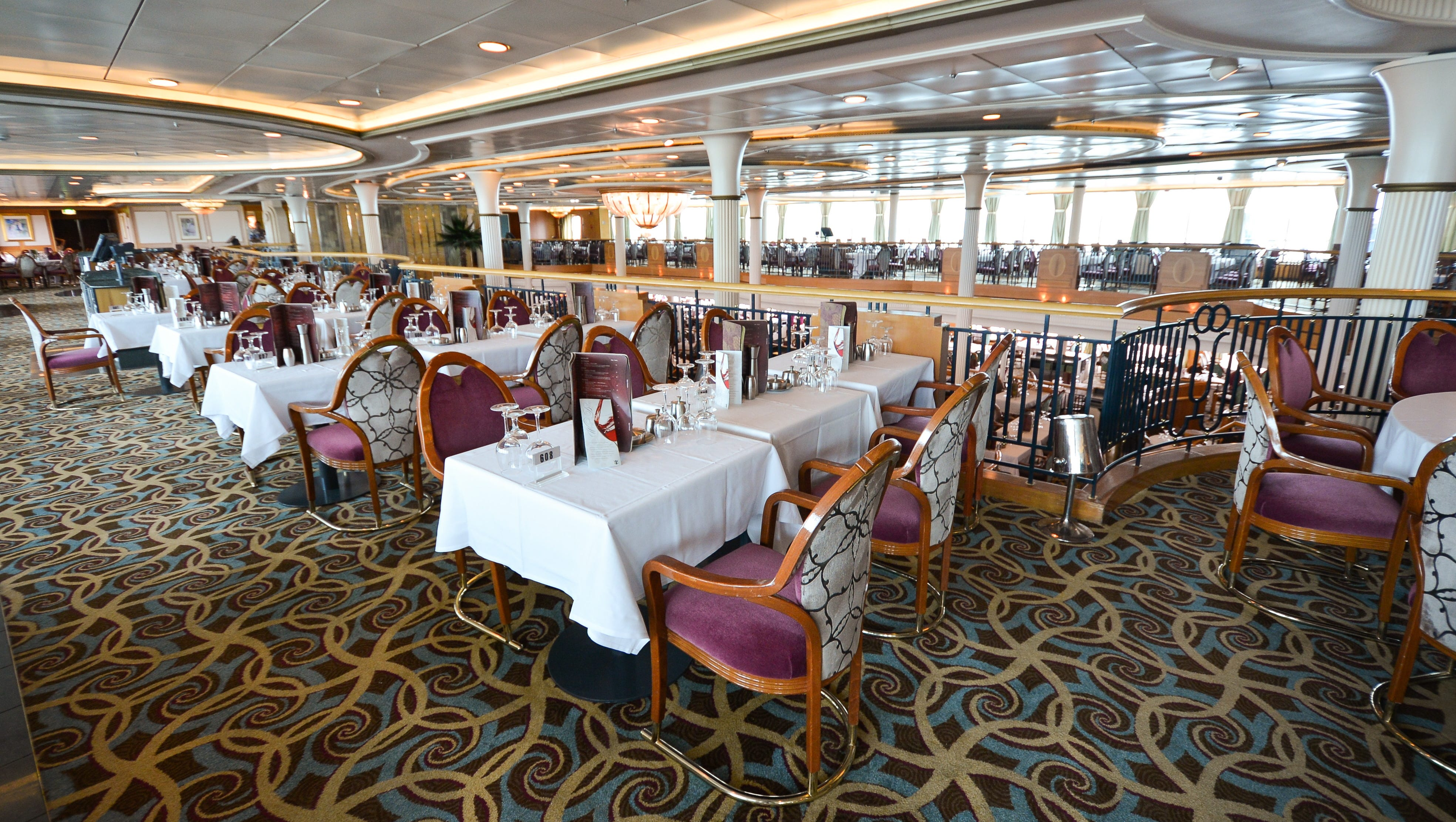 The Great Gatsby Dining Room can hold 1,039 passengers at a time and is available at no extra charge.