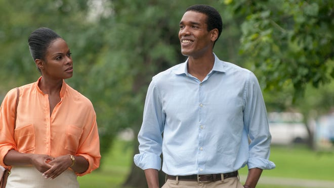"""Michelle Robinson (Tika Sumpter, left) isn't sure what to make of her law firm's new summer associate, Barack Obama (Parker Sawyers) in """"Southside With You."""""""