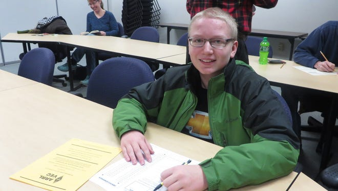 Isaac Lundberg, 13, of Fond du Lac,  takes the ham radio license exam at Moraine Park Technical College . The seventh grader aced the test.