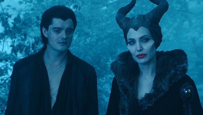 """Diaval (Sam Riley) & Maleficent (Angelina Jolie) in a scene from """"Maleficent"""""""