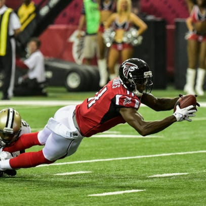 ATLANTA, GA - SEPTEMBER 07:  Julio Jones #11 of the Atlanta Falcons reaches for extra yardage in the first half against the New Orleans Saints at the Georgia Dome on September 7, 2014 in Atlanta, Georgia. The Atlanta Falcons won 37-34.  (Photo by Scott Cunningham/Getty Images)