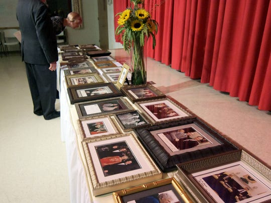 Photos from Bill Goodling's political life cover tables