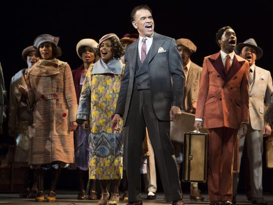 "Brian Stokes Mitchell (center) and the cast of ""Shuffle"