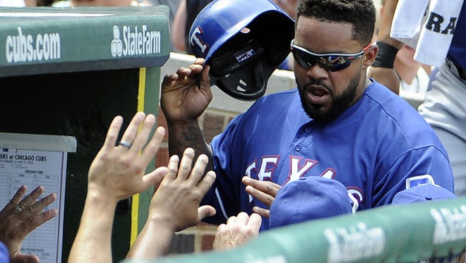 The Texas Rangers' Prince Fielder, right, is greeted after scoring July 17, 2016, in Chicago.