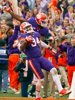 Clemson linebacker Quandon Christian (34) celebrates after recovering a fumble and scoring a touchdown in the second quarter against The Citadel.