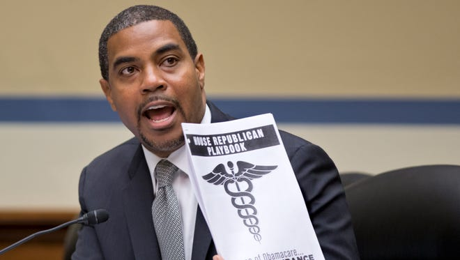 Rep. Steve Horsford, of Nevada, a Democratic member of the House Oversight Committee, holds a document called the House Republican playbook, which he waved in the direction of the GOP side of the committee during a hearing on the problems with implementation of the Affordable Care Act healthcare program, on Capitol Hill on Nov. 13, 2013.