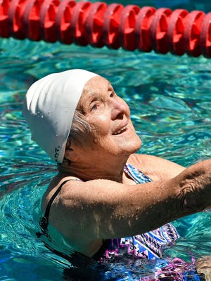 Stasia Kowalski, 92, prepares to compete in the 100-meter backstroke at Lakeside Swim Club in Louisville on Saturday, July 29, 2017.