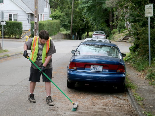 Joesph McNeal sweeps up on 15the street and Elizabeth in Bremerton on a one way street with a two hour parking sign.
