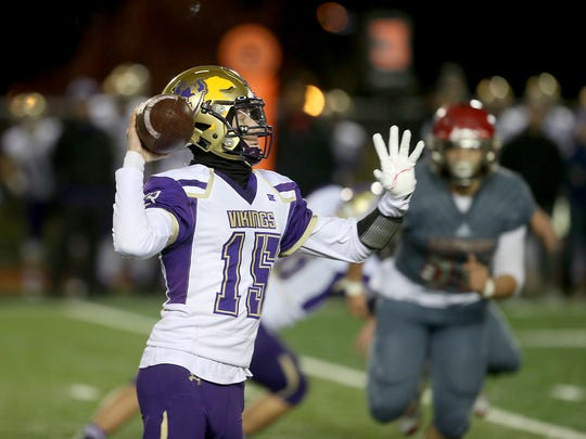 North Kitsap quarterback Andrew Blackmore looks to pass aganist  Archbishop Murphy at Veterans Memorial Stadium in Snohomish on Friday.