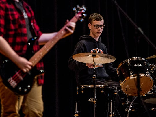 Heath freshman, Adian Schaffer, plays on stage at Heath high school with his band, The Rapid Jags. Shaffer and his band mates, Logan Gallant and Jack Lutz will be playing in a battle of the bands at the Rock and Roll Hall of Fame later this month.