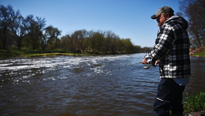 Kevin Johnson, of Sioux Falls, fishes from the shores of the Big Sioux River on Thursday at Baltic River Park in Baltic.