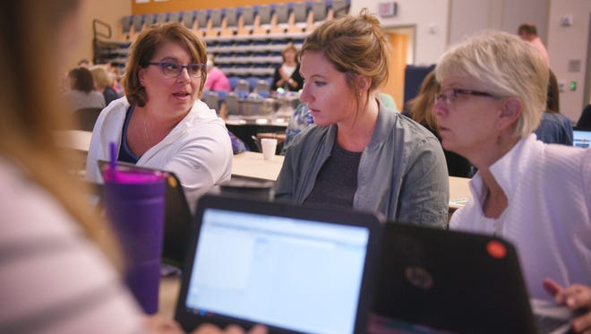 Lowell Elementary School Literacy in Action educator Shelly Schnetter, from left, Lowell third grade teacher Jaicee Twedt and Lowell LIA educator Karen Lukens attend a two day intensive training in preparation for new computer science immersion at Lowell Elementary School starting this year Thursday at Augustana University in Sioux Falls.