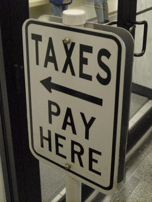 Residents pay their property tax bills at the Brown County Treasurer's office.