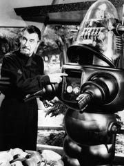 "Dr. Morbius (Walter Pidgeon) and Robby the Robot are two of the most memorable characters from 1956's ""Forbidden Planet."""