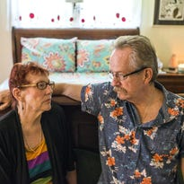 Victoria and Gordon Clark sit in the bedroom they rent out for short term guests at their Woodfin home earlier this month. The couple have lived in the home for three years and are involved in the task force for deciding what kinds of short-term rentals, if any, are to be allowed in the town.