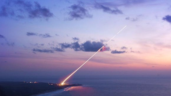 A Terminal High Altitude Area Defense (THAAD) missile launch at sunset.