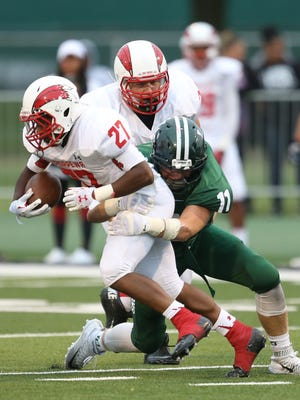 Chippewa Valley high schools Daren Greeley is tackled by Lake Orion high schools Jack McClear during first half action of the Prep Kickoff Classic on Thursday, August 27, 2015 at Wayne States Tom Adams Field in Detroit Michigan.