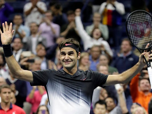 Roger Federer, of Switzerland, celebrates after defeating Frances Tiafoe, of the United States, at the U.S. Open tennis tournament, Tuesday, Aug. 29, 2017, in New York. (AP Photo/Julio Cortez)