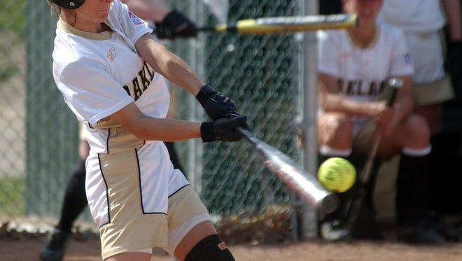 Oakland University's Nina Catanzaro hits a single to in the second inning against Detroit Mercy on April 15, 2003, in Rochester.