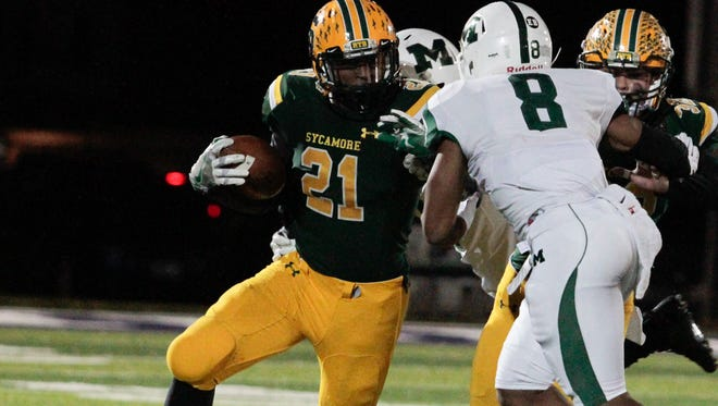 Ra'von Bonner of Sycamore gets out on the edge for the Aves against Mason at Barnitz Stadium in Middletown on Friday, November 11, 2016.
