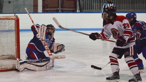Carmel goalie Willow Barnes deflects a third-period