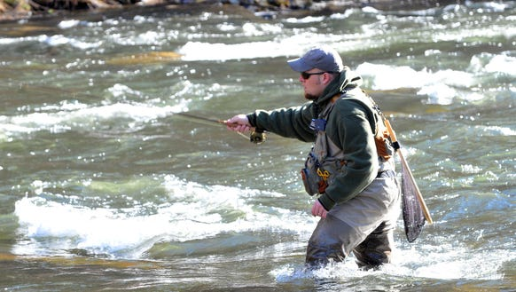 Bob Lux works on hooking a fish during the Fly Fishing