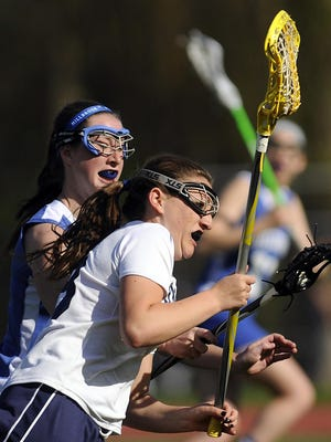 Highland High School's Samantha Mazzella, front, is defended by Millbrook's Stacey Widera on Tuesday in Lloyd. May 6, 2014