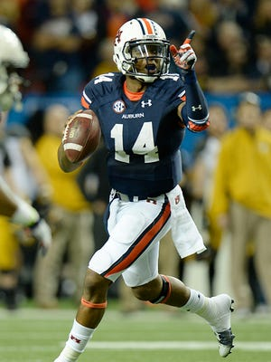 Auburn Tigers quarterback Nick Marshall (14) motions to pass during the second quarter against the Missouri Tigers of the 2013 SEC Championship game at Georgia Dome.