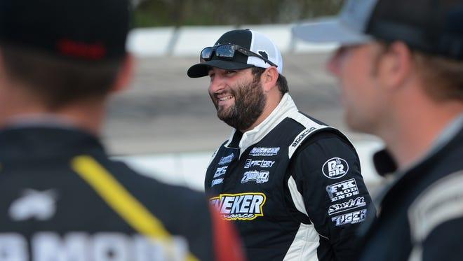 Bubba Pollard of Senioa, Ga., waits for driver introductions earlier this season at Madison International Speedway.