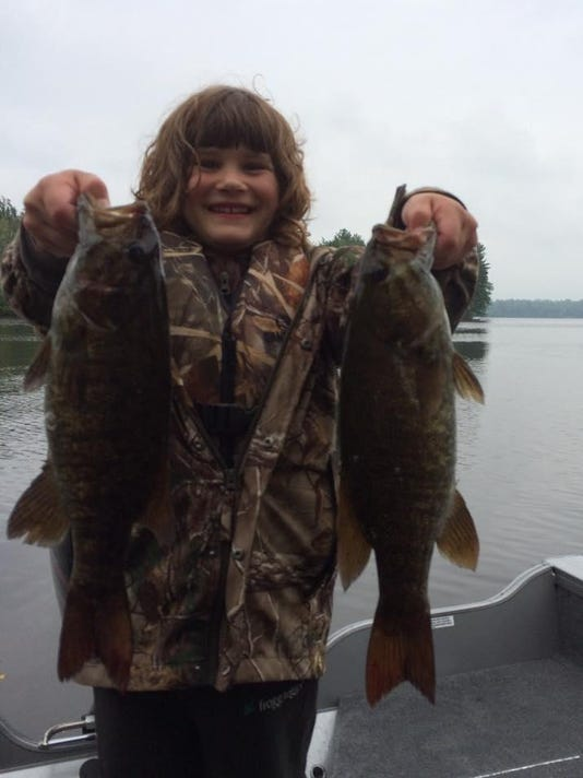Jayden Reed with a couple of nice smallmouth bass.