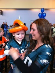 Jacquelyn Jackson and her son, Chase, will go to the Eagles' Huddle up for Autism event for the third time Sunday.