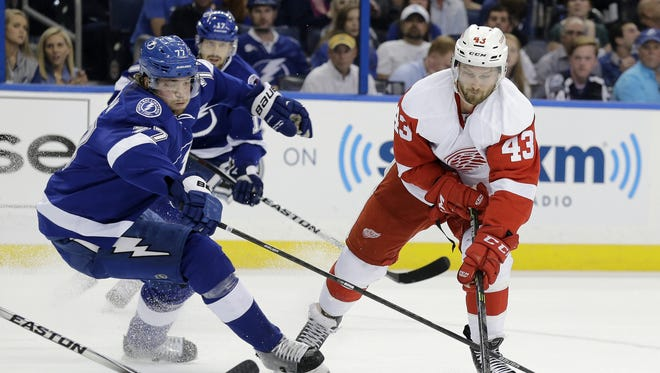 Detroit Red Wings center Darren Helm (43) gets around Tampa Bay Lightning defenseman Victor Hedman (77), of Sweden, during the first period of Game 7 of a first-round NHL Stanley Cup hockey playoff series Wednesday, April 29, 2015, in Tampa, Fla.