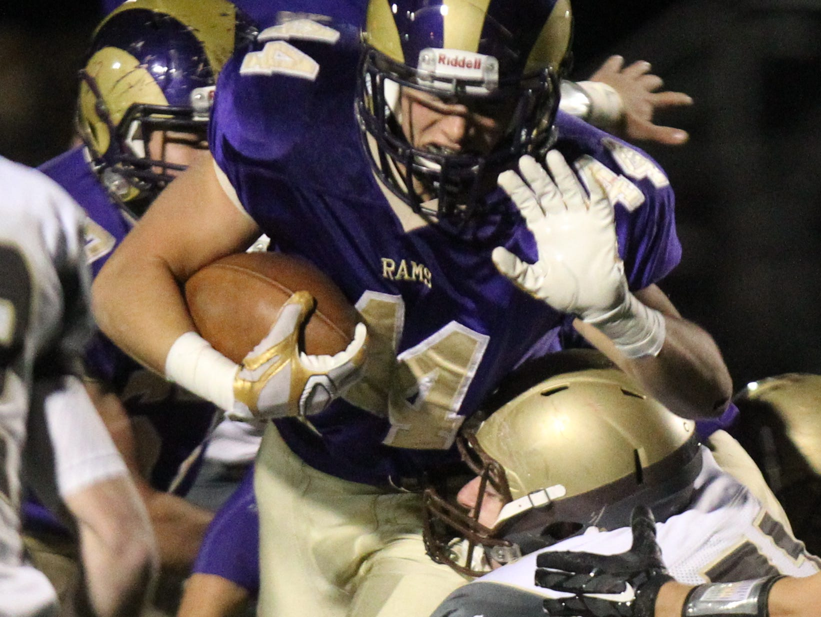 Clarkstown North's Michael Porco is tackled by Clarkstown South's Vince Maraia during their Class AA quarterfinal at Clarkstown North Oct. 23, 2015. 51