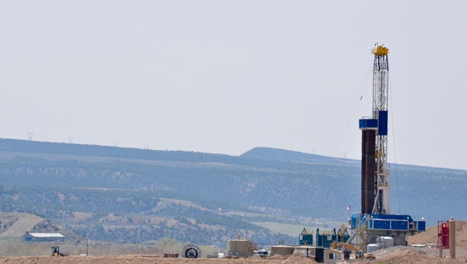 This undated photo file photo shows a drilling rig near Parachute, Colo.