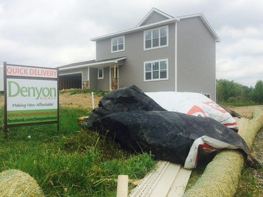A home under construction at the edge of the Ridgeview Subdivision in Weston, seen on Friday, July 24, 2015. The village is considering whether to cover all or part of the cost of a road to a third neighborhood entrance.