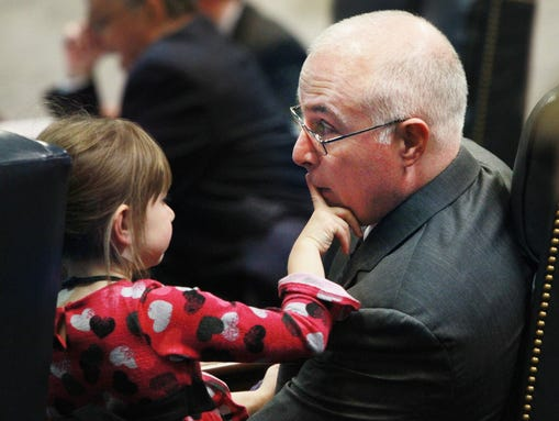 Lilly Delph, 6 1/2-year-old daughter of Sen.Mike Delph, R-Carmel, interacts with her father at his Senate seat as the Senate attempts to wrap up business for the year on Friday, April 26, 2013. Charlie Nye / The Star.