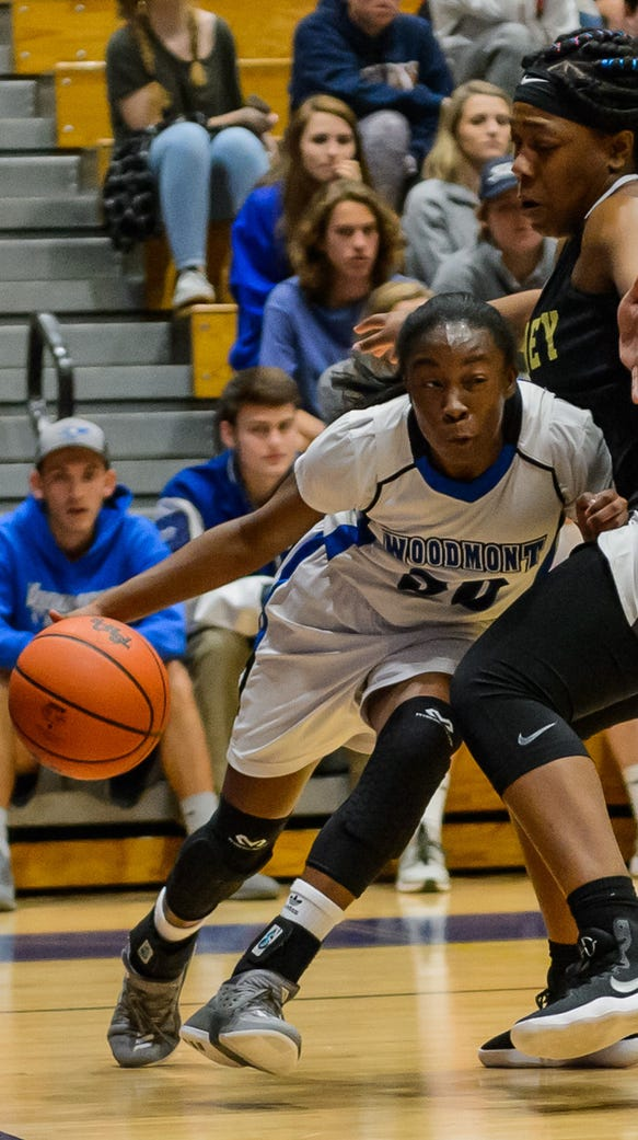 Woodmont's JaRae Smith (30) drives the baseline against