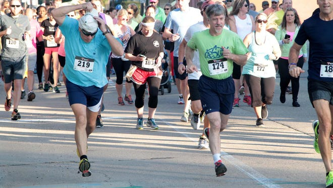 Runners and walkers take off at the 2015 CenturyLink Dash 'n Dine/Walk n' Wobble 5K Run/Walk. This year's event, part of the North Delta Food and Wine Festival, is 8-11 a.m. Saturday.