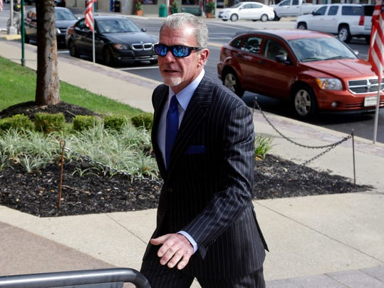 Indianapolis Colts owner Jim Irsay enters Hamilton County court in Noblesville, Ind., Tuesday, Sept. 2, 2014. Irsay is scheduled to appear in court for a change-of-plea hearing on drug-related charges he faces from a traffic stop in March.  (AP Photo/Michael Conroy)