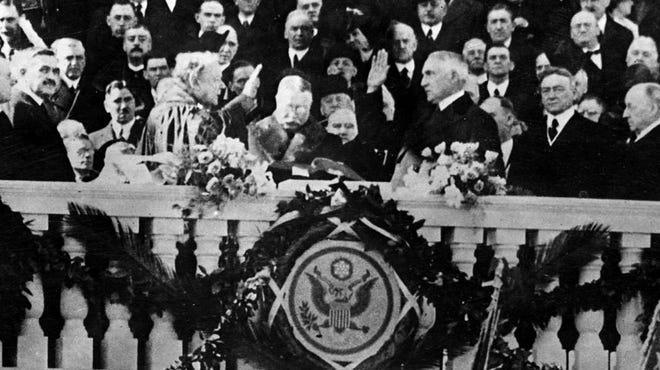 Warren G. Harding is sworn in as president in 1921.