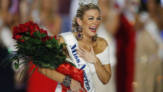 In this Jan. 12, 2013 file photo, Miss New York Mallory Hytes Hagan reacts as she is crowned Miss America in Las Vegas. Hagan's appearance and sexual habits were mocked in the emails.