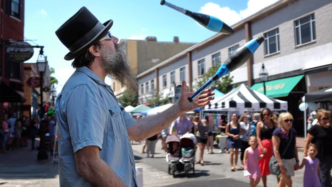 Pete Spofford juggles at the corner of Congress and Chestnut streets during Pro Portsmouth's 40th annual Market Square Day. The 2020 version is virtual due the COVID-19 pandemic.