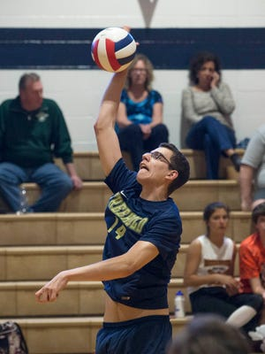 Freehold's Joe Elias hits a return shot during second game of Freehold vs Howell Boys Volleyball  in Howell, NJ on May 2, 2017