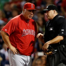Aug. 21: Angels manager Mike Scioscia, is thrown out of the game after Albert Pujlos was ejected during the sixth inning against the Boston Red Sox at Fenway Park.