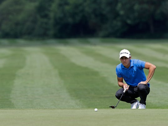 Joakim Lagergren of Sweden lines up a putt during the third round of the German Open golf tournament in Eichenried near Munich, Germany, Saturday, June 24, 2017. (AP Photo/Matthias Schrader)