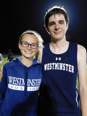 Jackie Laberteaux (left) and Devin Davis, pictured here following their victories at the St. Landry Parish track meet earlier this month, have qualified for the Class 1A track meet scheduled next Friday at LSU in Baton Rouge. The two long distance runners were among several Westminster athletes qualifying for the state meet.