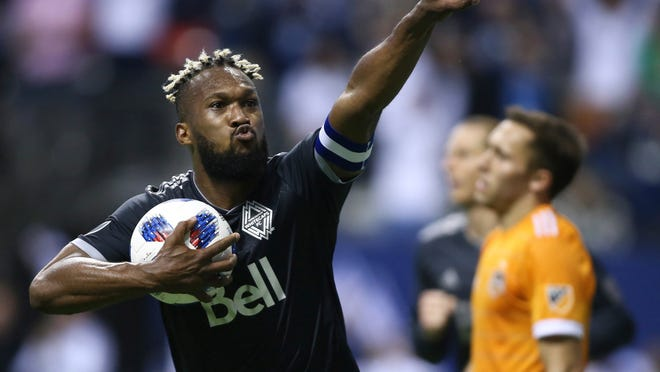 FILE - In this May 11, 2018, file photo, Vancouver Whitecaps defender Kendall Waston celebrates his goal against the Houston Dynamo during the second half of an MLS soccer match in Vancouver, British Columbia. When it was announced Waston would be part of Costa Rica's 23-man roster headed to Russia for the World Cup, he was surrounded by his Whitecaps teammates, the announcement made by the club's head coach Carl Robinson. The applause, the good wishes, the water-bottle shower that followed was a sign of the respect and admiration Waston has earned during the time with his club. (Ben Nelms/The Canadian Press via AP, File)