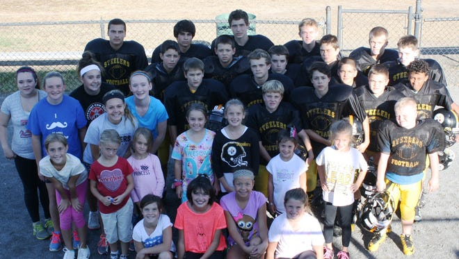 Pictured are representatives from each of the Plymouth-Canton Steelers football and cheerleading squads that will be putting their gridiron and sideline skills on display Oct. 4 at the University of Michigan's football stadium.